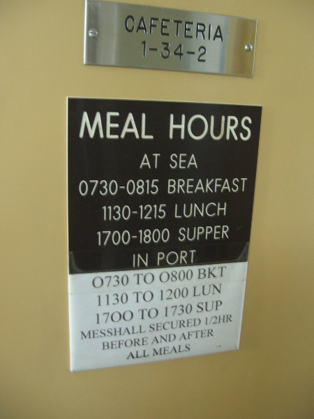 Meal hours are posted on door leading to the cafeteria.