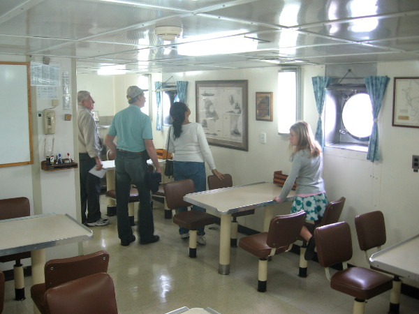 Visitors check out the mess hall where crew and research scientists enjoyed a break, to eat, talk and share knowledge.