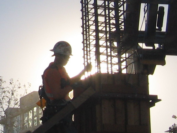 Silhouette of worker as morning sun lights the downtown San Diego sky.