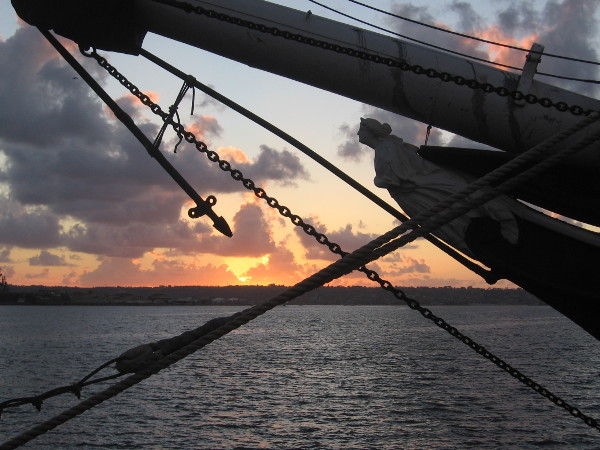 Fiery sunset in late February behind figurehead of Star of India.