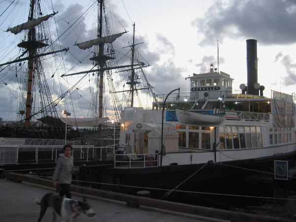 HMS Surprise and steam ferryboat Berkeley at nightfall on the Embarcadero.