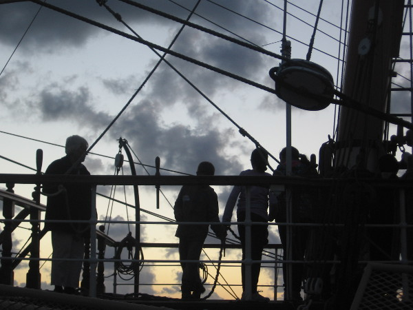 Students hauling a rope learn about sailing and seamanship on Star of India.