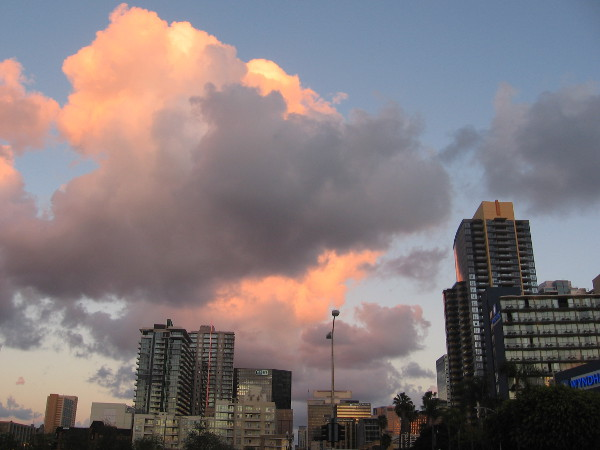 Looking eastward as day ends. Amazing glowing color above downtown buildings.