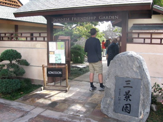 People enter Japanese Friendship Garden. The San-Kei-En entrance stone, gift from San Diego's sister city Yokohama, translates Three Scene Garden--Water, Pastoral and Mountain.