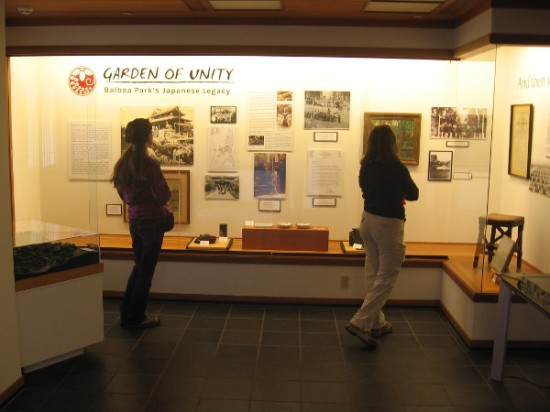 Visitors check out thought-provoking historical and cultural displays in the Exhibit House.