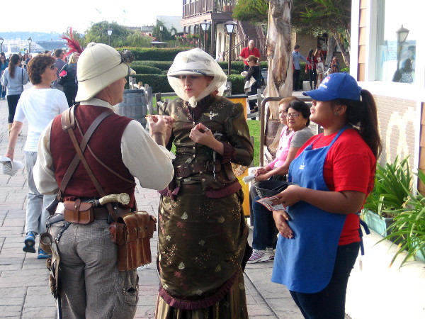 Two adults in historical costumes at Seaport Village. I don't know why!