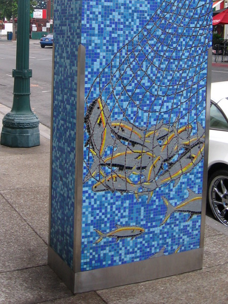 Base of Little Italy Landmark Sign shows fish netted in the ocean.