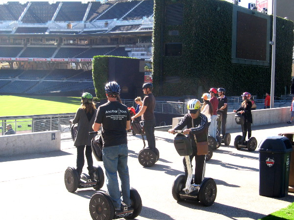Tour group on Segways stops in Petco's Park at the Park to gaze at empty field.