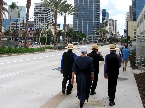 Amish tourists taking an odd stroll through a strange, big city!