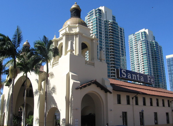 The Santa Fe Depot as it appears today, with modern high-rise buildings nearby.