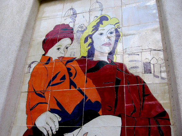 A closer examination of the mother and child tile mural in Little Italy.