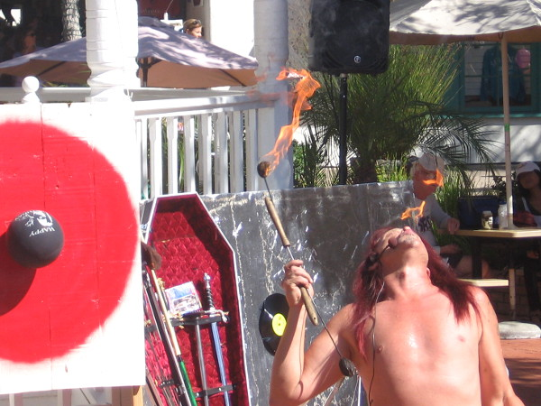 Fire eating preceded balancing on a sword, being crushed on a bed of nails, and shooting a flaming arrow from his throat!