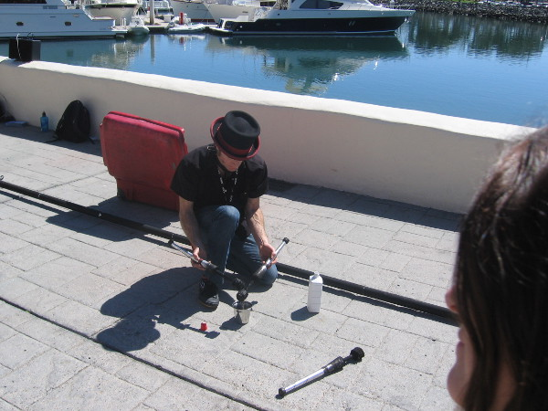 Derek McAlister prepares to open his amazing act with some fire juggling by Marriott Marina at Seaport Village.