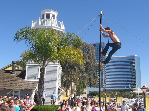 Derek McAlister climbs a 20-foot Chinese pole and performs fantastic aerial acrobatics at the Spring Busker Festival.