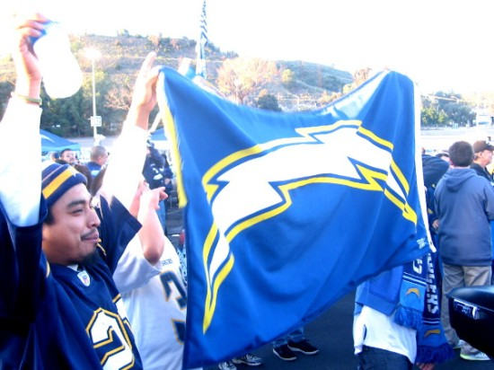 Legions of local football fans waved banners of blue and gold.