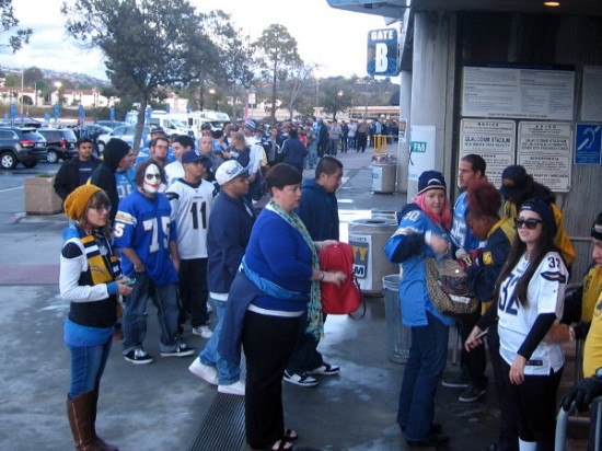 A long line of people waited to enter Qualcomm Stadium to attend or watch the public hearing.