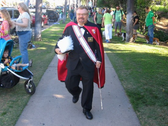 This smiling gentleman is dressed in the uniform of the Knights of Columbus.