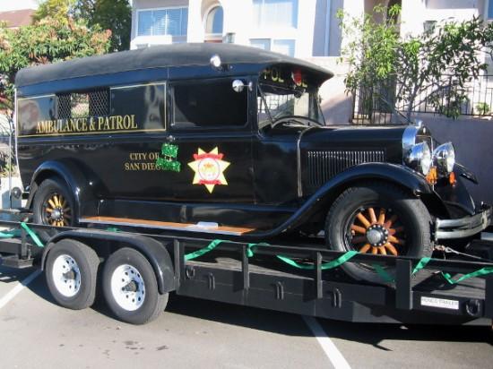 This cool old Ambulance and Patrol vehicle awaits start of parade.