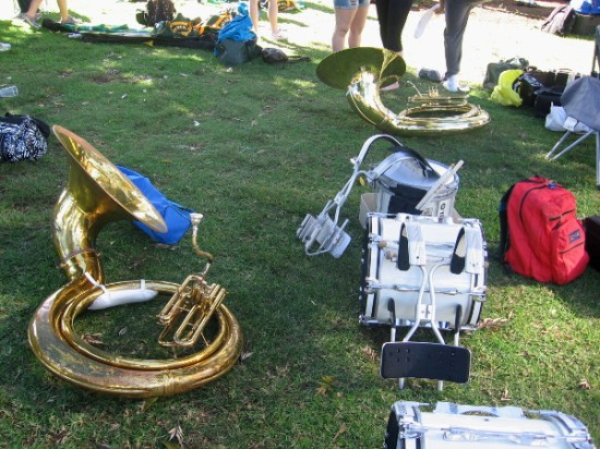 Marching band instruments lie on the grass before start of the St. Paddy's parade.