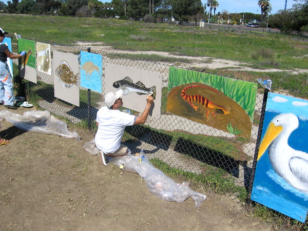 Adults were putting some finishing touches on cool public art.