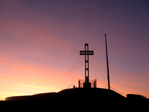The cross is a landmark that can be seen for many miles in every direction. The flagpole is bare at this early hour.