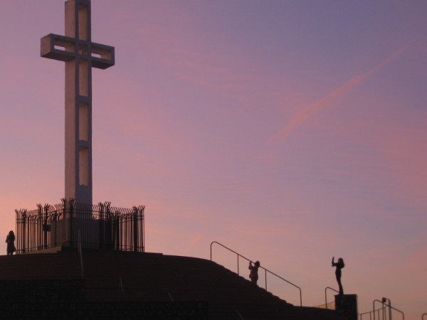 Early morning visitors to Mount Soledad take photos of the 29 foot high cross.