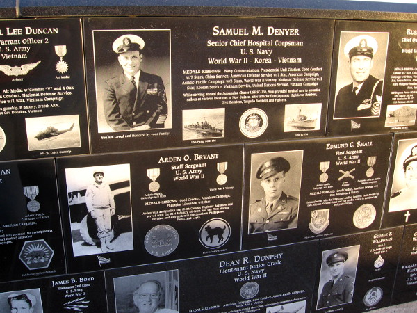Photo plaques honor both living and dead members of United States uniformed services.