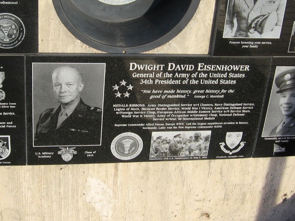 General and President Dwight D. Eisenhower's plaque is added to a host of other plaques representing those who served with equal honor.