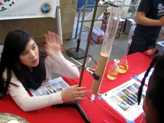Lady demonstrates how bio fuels are refined using filtration.