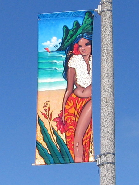 Encinitas street banner depicts a tropical island girl.