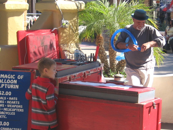 Carefree, easy fun at every turn. These guys are by the Seaport Village carousel.