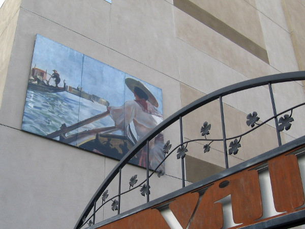 Mural high on side of building depicts Venetian gondoliers.
