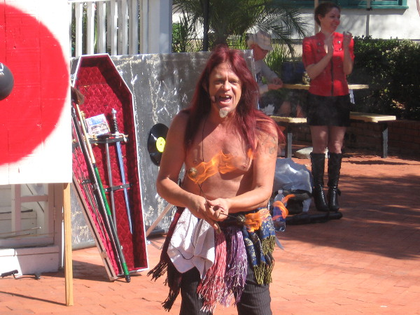 Murrugun the Mystic from AMC show Freakshow begins his busker festival danger act with fire eating.