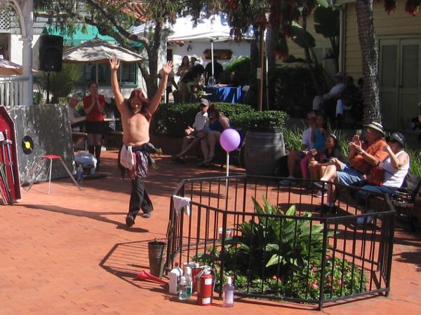 Murrugun the Mystic makes his entrance near Seaport Village's gazebo in the Plaza East.
