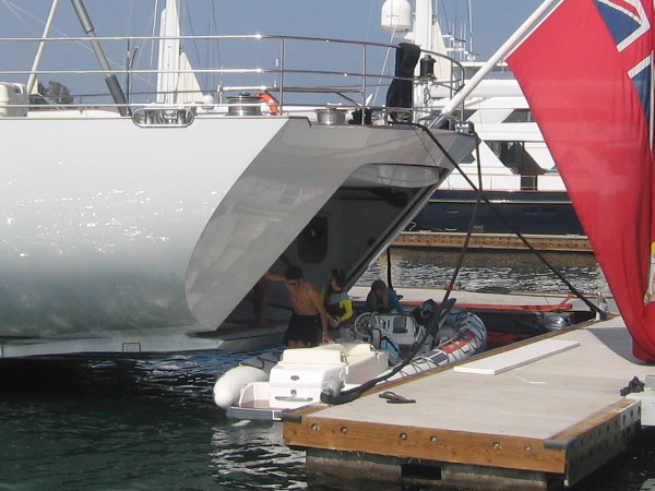 People enjoying a day on San Diego Bay return to sailing super-yacht M5.