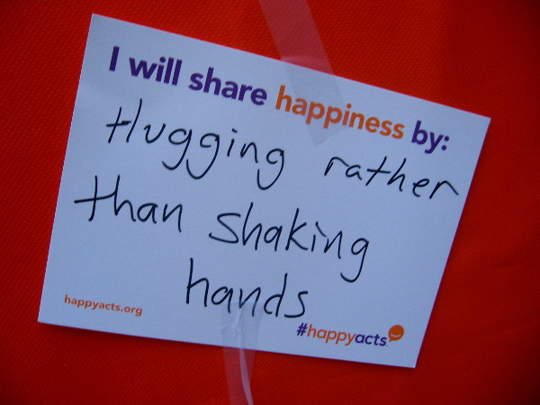Hugging rather than shaking hands.