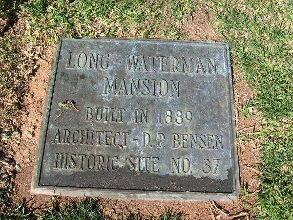 Plaque in front yard of 1889 Long-Waterman mansion.