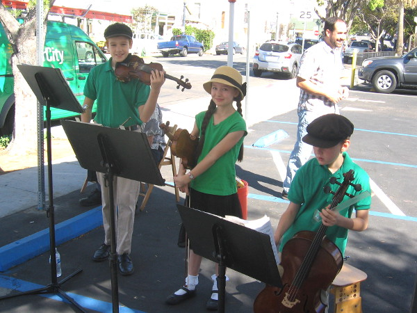 The musical family plays one Saturday at the Little Italy farmers market.