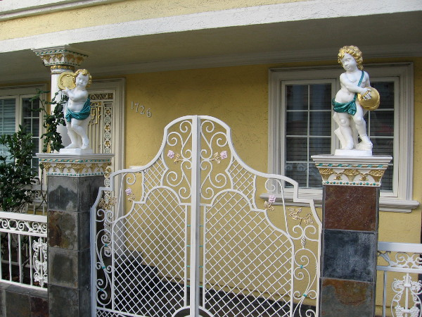 Two cherubs adorn gate pillars on India Street.