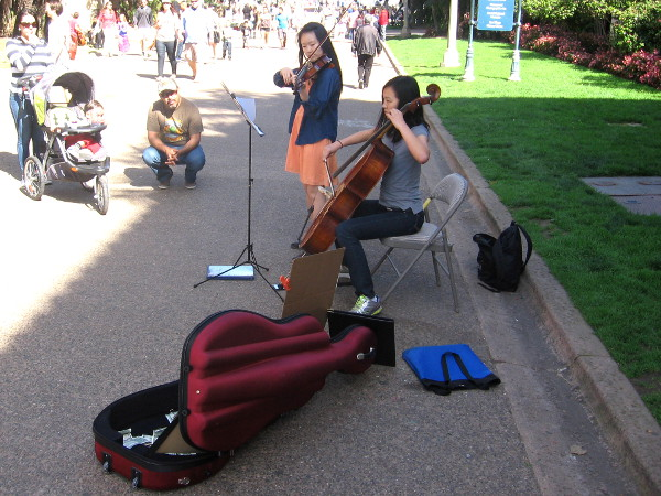 Young ladies perform classical music in Balboa Park to help raise money for a very worthy cause!