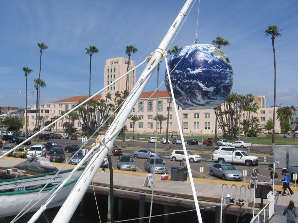 Our big blue marble Earth dangles in the sky on San Diego's Embarcadero for an Earth Day event.