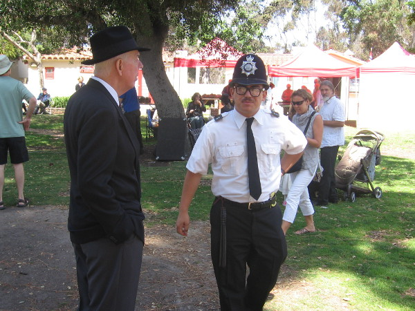 British bobby on patrol talks to a gentleman at unique Balboa Park event.