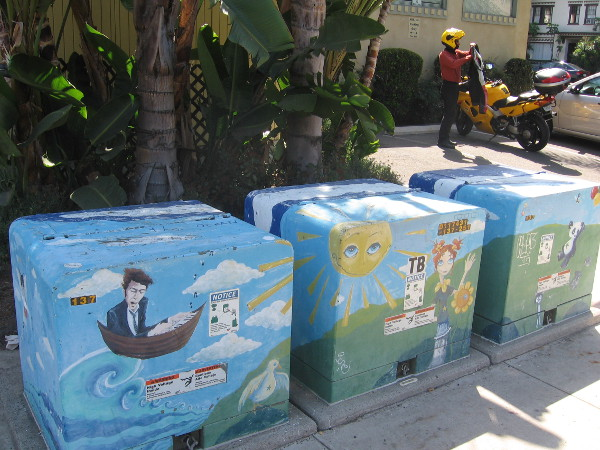 These three transformer boxes in Bankers Hill are painted with unbounded imagination.