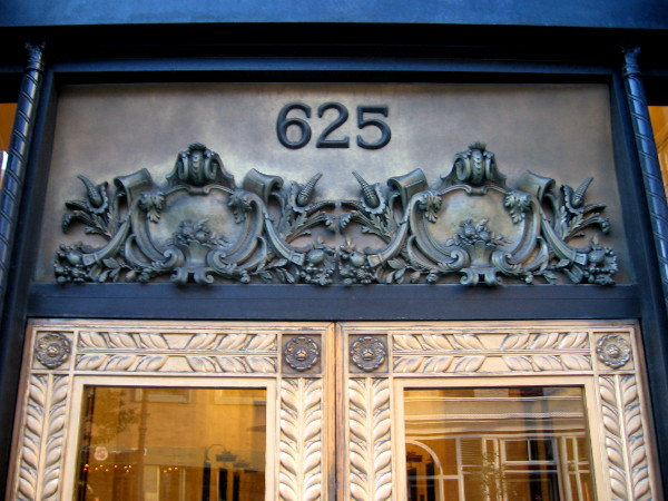 Beautiful ornamental artwork at the door of 625 Broadway in San Diego.