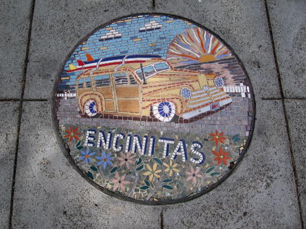 Encinitas woody with surfboard.