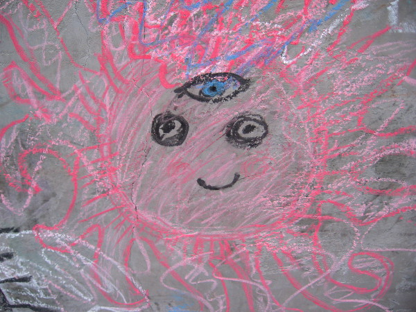 This bright, smiling chalk face is gifted with a third eye.