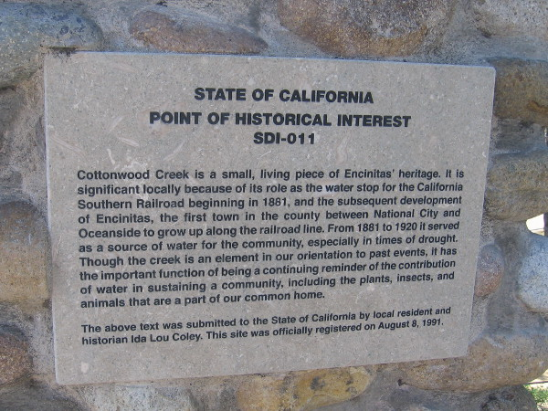 Sign on Pacific Coast Highway explains history and importance of Cottonwood Creek.