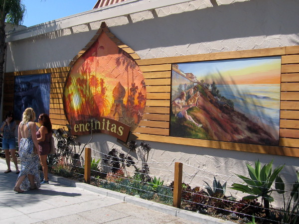 Colorful murals along the sidewalk in this happy, carefree beach town.