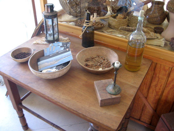 Various items on display include lantern, candle, bottle, ship's food and native Kumeyaay artifacts.
