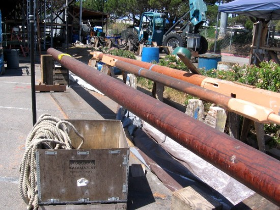 Wood mast segments and yards are coasted with linseed oil, I believe. They'll be installed once the ship is afloat in San Diego Bay.